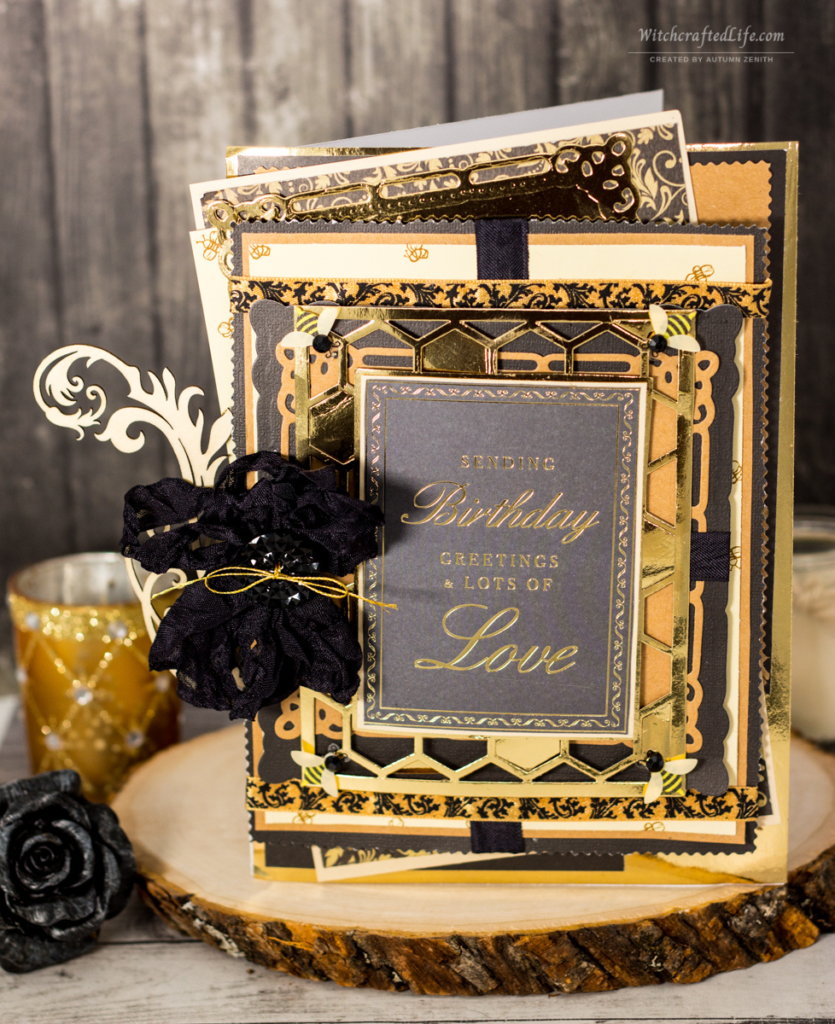 Photo of a handmade black, gold, and cream colour bee and honeycomb themed elegant masculine birthday card