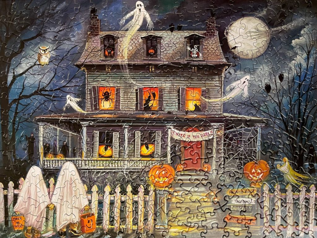 Photo of the complete Enter If You Dare 300 piece Halloween trick-or-treating haunted house scene jigsaw puzzle.
